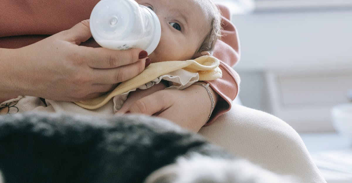 A close up of a person holding a baby